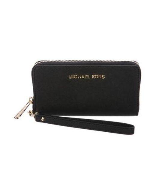 f4701aaab34e MICHAEL Michael Kors - Metallic Michael Kors Leather Zip-around Wallet Black  - Lyst ...