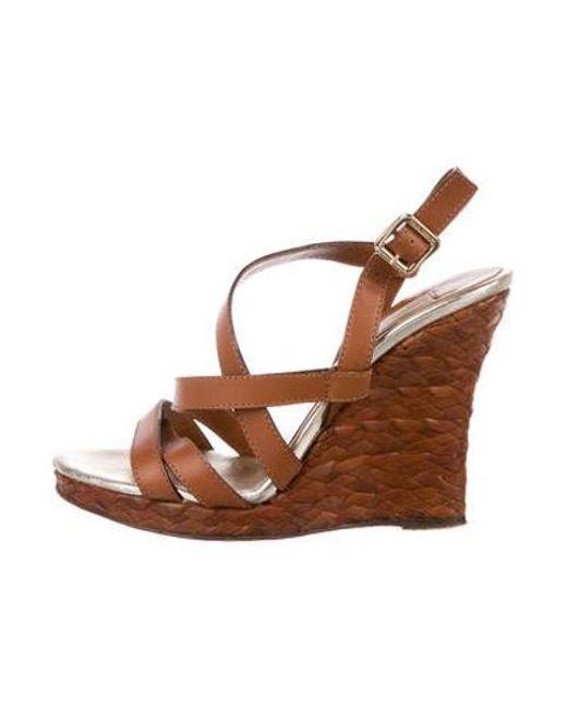ed453acaca Michael Kors - Brown Straw Wedge Sandals - Lyst ...
