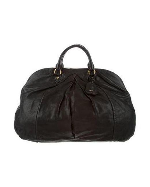 ce053378fe8a Miu Miu - Metallic Miu Pleated Leather Handle Bag Black - Lyst ...