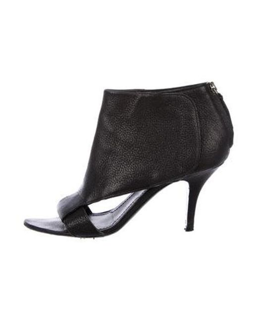 f6a202ce48a1 Givenchy - Black Leather Cutout Booties - Lyst ...