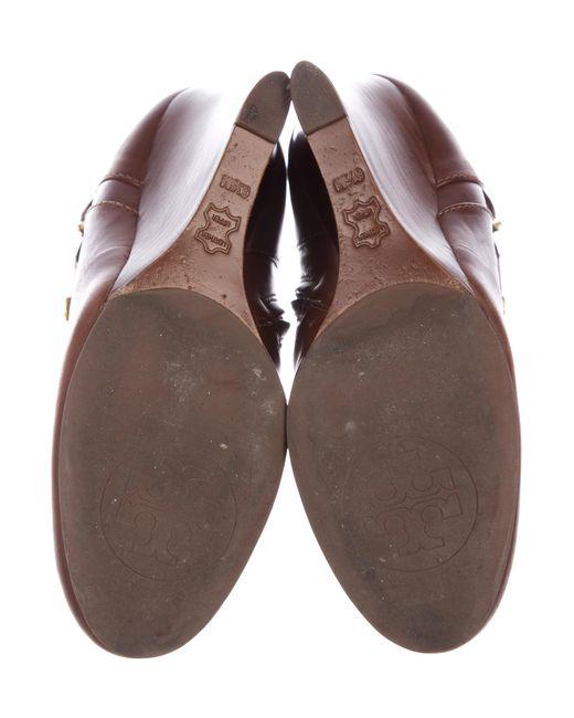 20f1b30e7de089 ... Tory Burch - Metallic Milan Leather Wedge Boots Brown - Lyst
