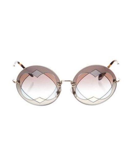 326e385e3 Miu Miu - Metallic Miu Heart Tinted Sunglasses Blue - Lyst ...