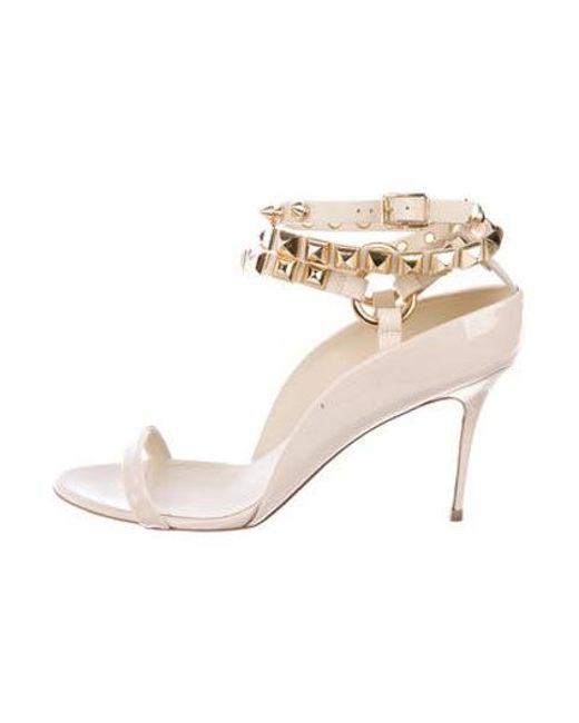 b6fdccadb1 Giuseppe Zanotti - Metallic Embellished Patent Leather Sandals Gold - Lyst  ...