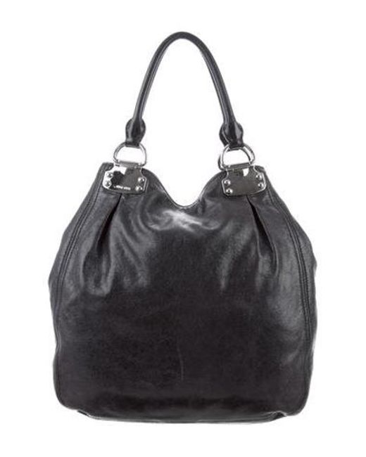 0699d8e962a3 Miu Miu - Metallic Miu Grained Leather Hobo Bag Black - Lyst ...
