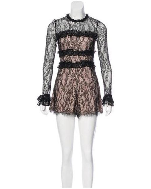 26113a72d442 Lyst - Alexis Long Sleeve Lace Romper in Black - Save ...