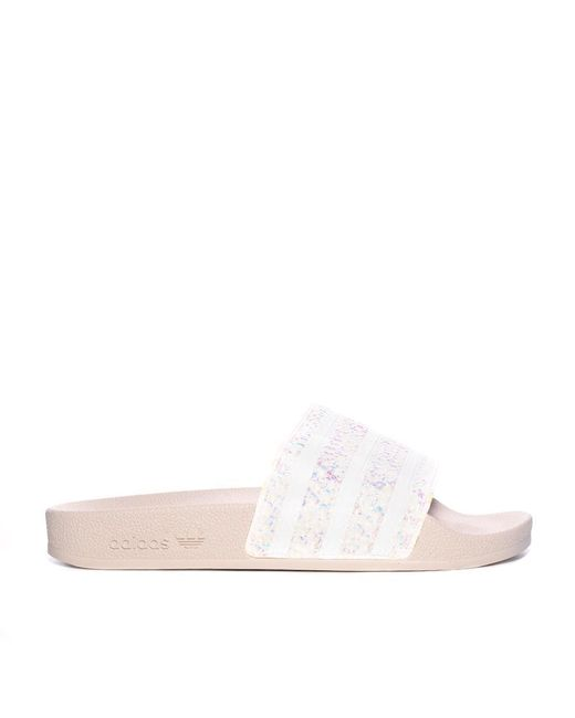 f3fe85e63 Lyst - adidas Adilette Slide Pink Glitter in Pink - Save 47%