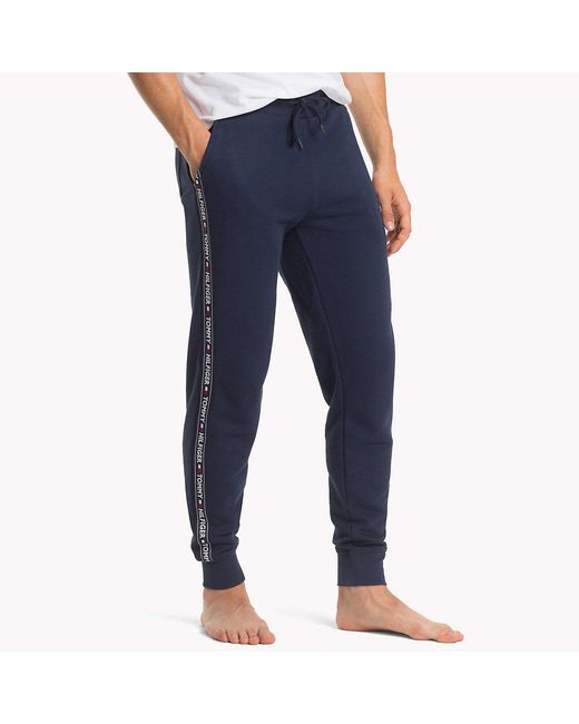 facabdada78 Tommy Hilfiger - Blue Logo Strip Joggers for Men - Lyst ...