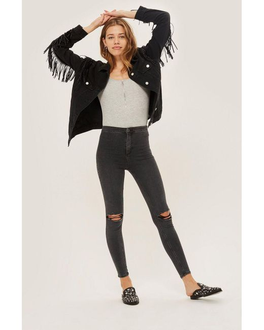 TOPSHOP - Moto Washed Black Ripped Joni Jeans - Lyst