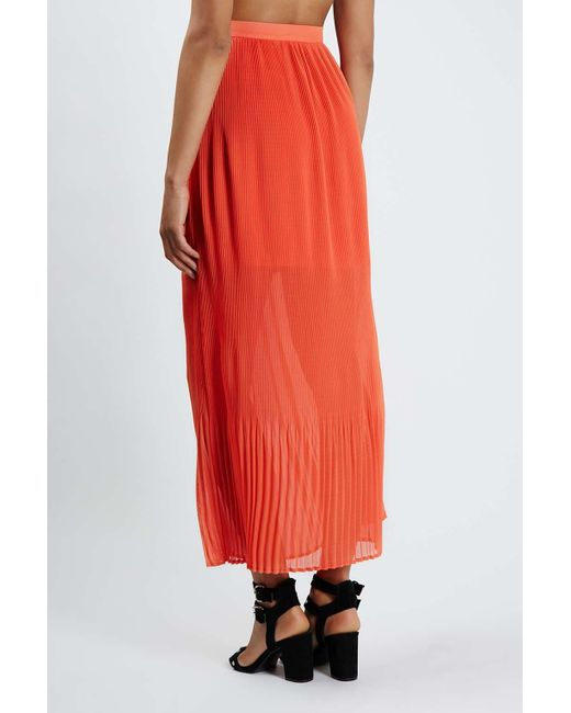topshop peace pleated maxi skirt by jovonna in orange lyst