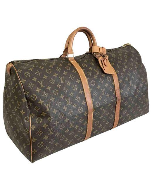 709db39c49 Sac de voyage Keepall en toile Louis Vuitton pour homme en coloris ...