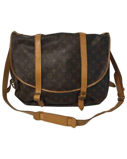 Louis Vuitton - Pre-owned Vintage Saumur Brown Cloth Travel Bags - Lyst
