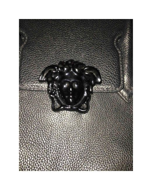 40be321f2579 ... Versace - Pre-owned Black Patent Leather Handbags - Lyst ...
