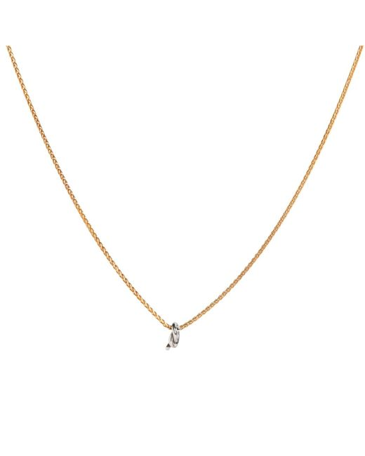 Dutch Basics - Metallic Gold Plated Necklace With Silver Knot Pendant - Lyst