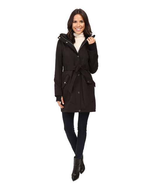 Jessica Simpson | Black Long Softshell W/ Faux Fur Collar And Hood | Lyst