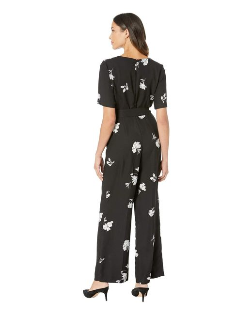 6cb8a7ab42b1 ... Vince Camuto - Elbow Sleeve Tossed Flowers V-neck Jumpsuit (rich Black)  Women s ...