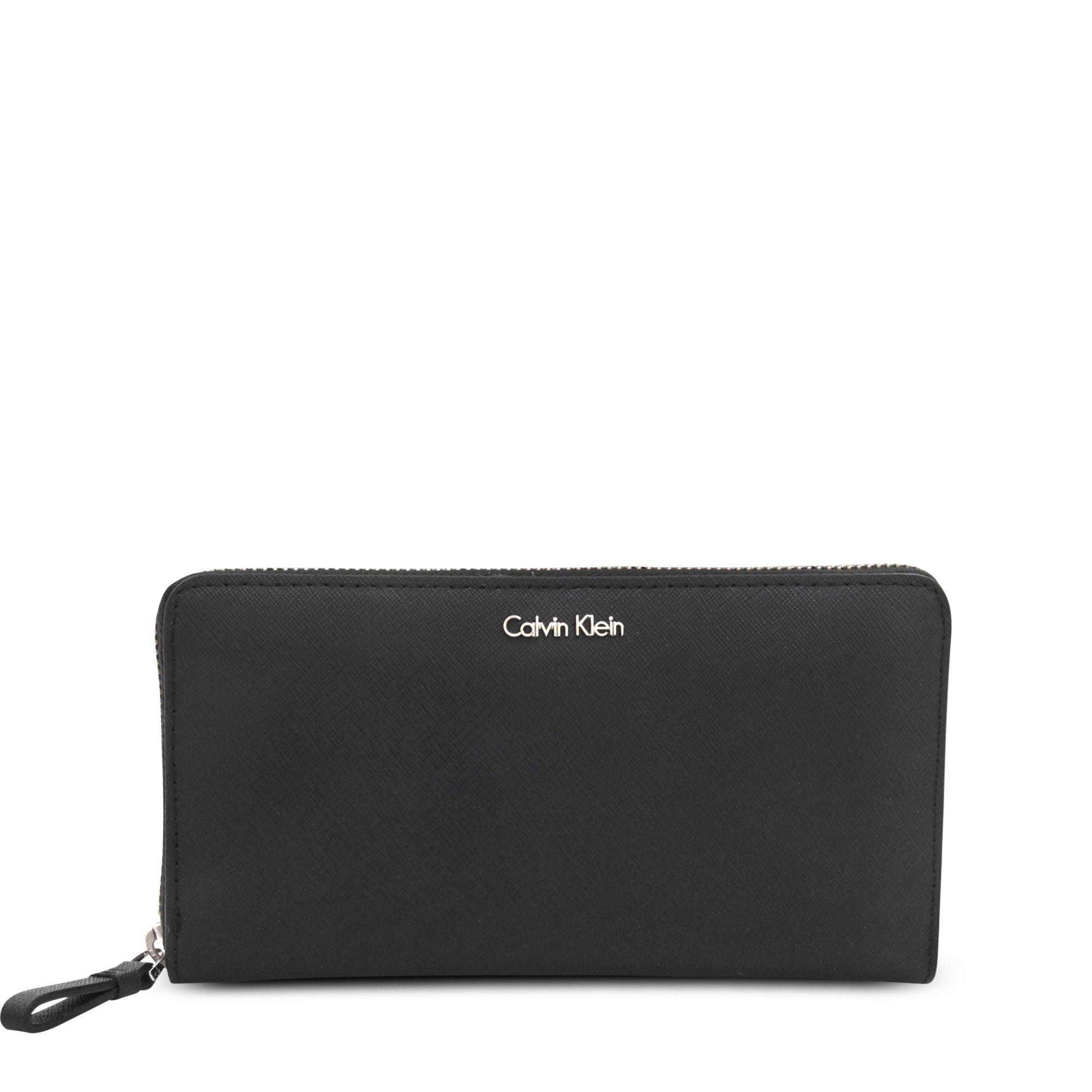 39e092b6db Calvin Klein Sophie Saffiano Zip Wallet in Black - Lyst