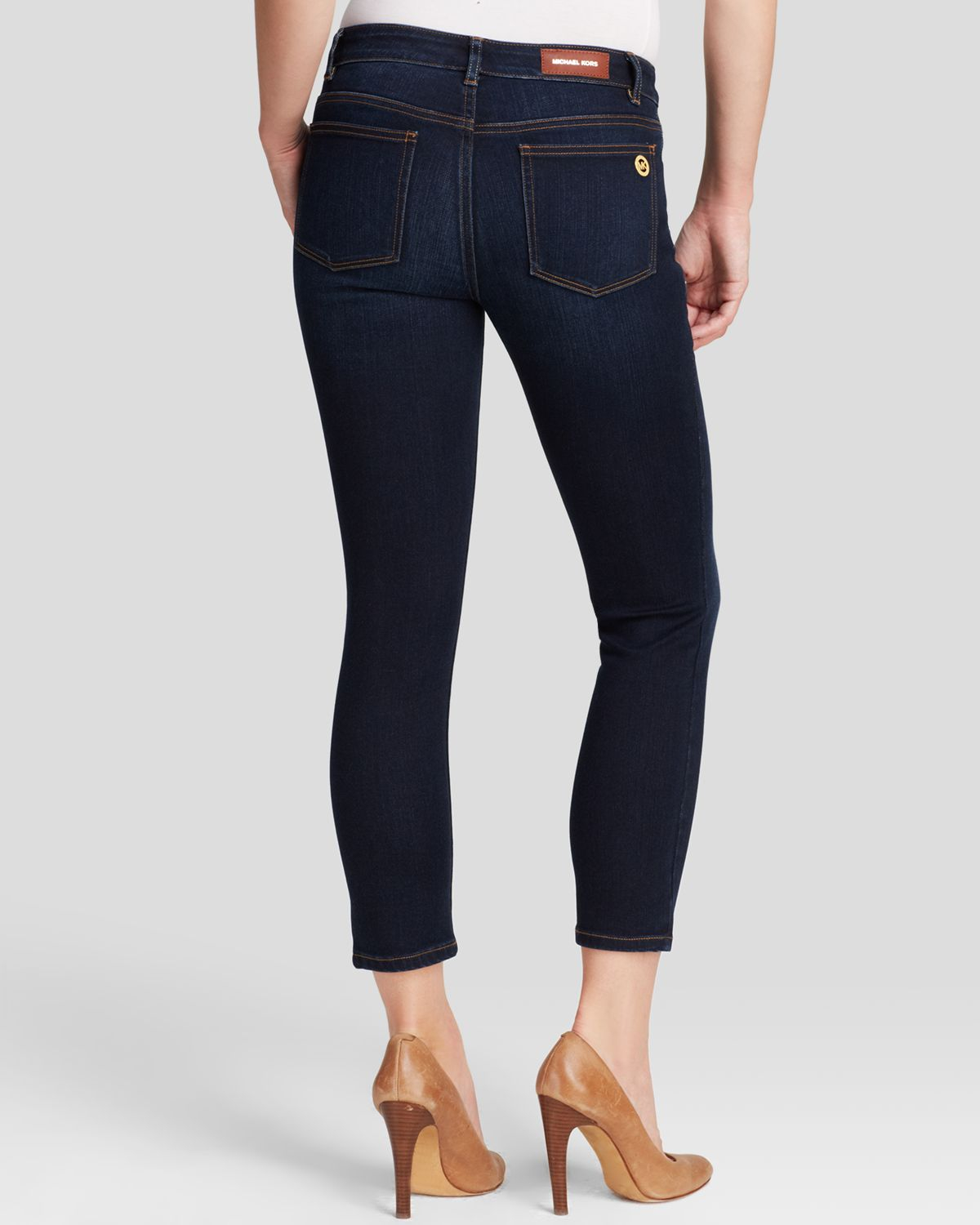 lyst michael michael kors cropped skinny jeans in midnight in blue. Black Bedroom Furniture Sets. Home Design Ideas