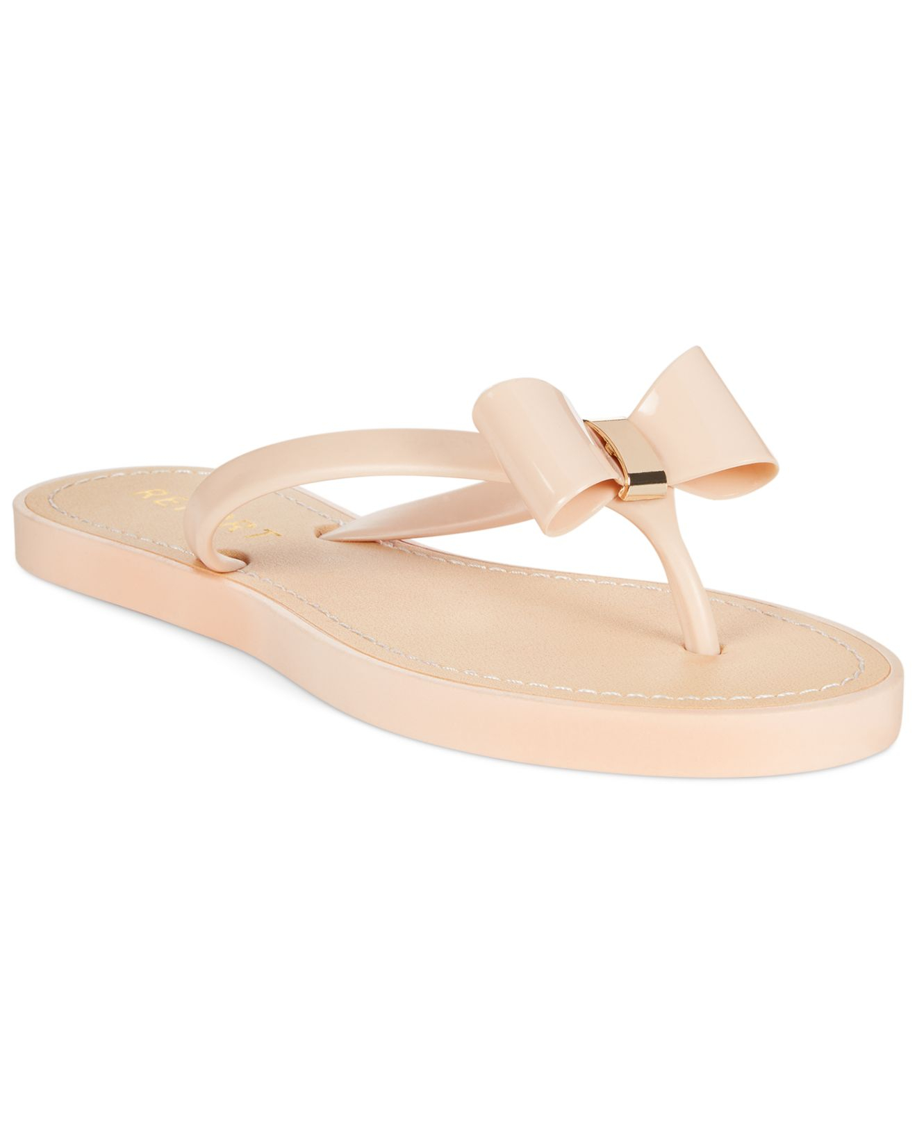 6b64bfb0a9ccec Lyst - Report Jenski Flat Bow Thong Sandals in Natural