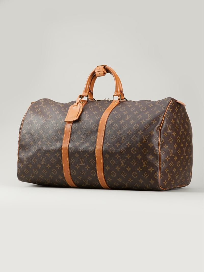 lyst louis vuitton 39 keepall 55 39 travel bag in brown. Black Bedroom Furniture Sets. Home Design Ideas