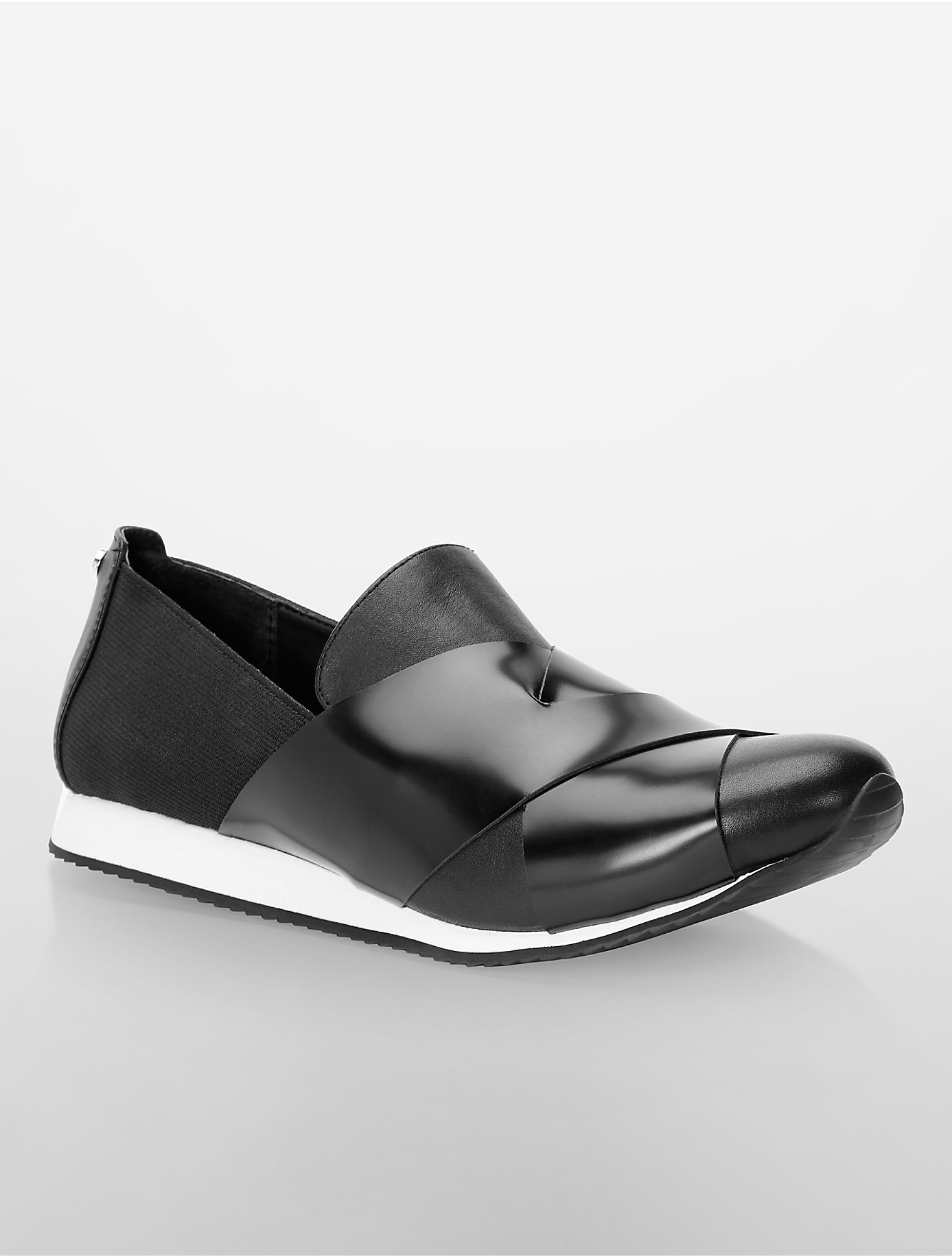 lyst calvin klein white label fox slip on sneaker in black. Black Bedroom Furniture Sets. Home Design Ideas