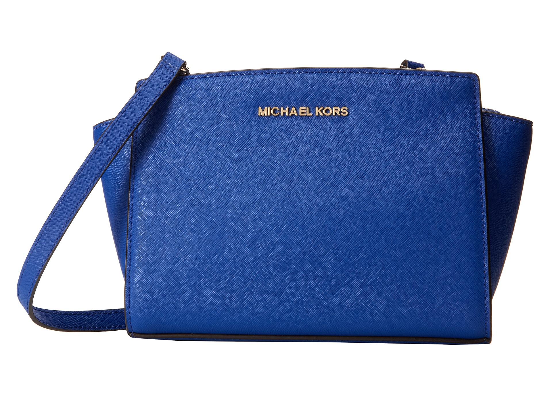 db55ef29b3b1 ... cheapest lyst michael michael kors medium selma messenger in blue 1c632  3e415