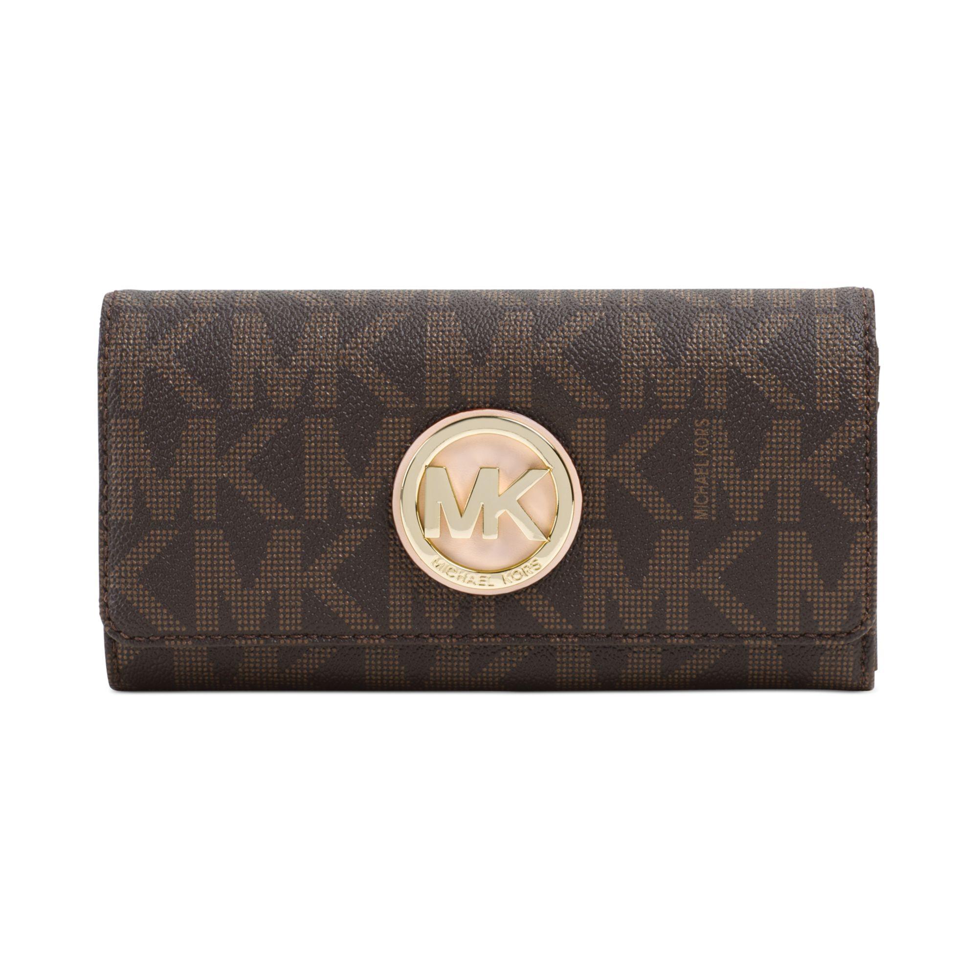 lyst michael kors michael fulton carryall wallet in brown