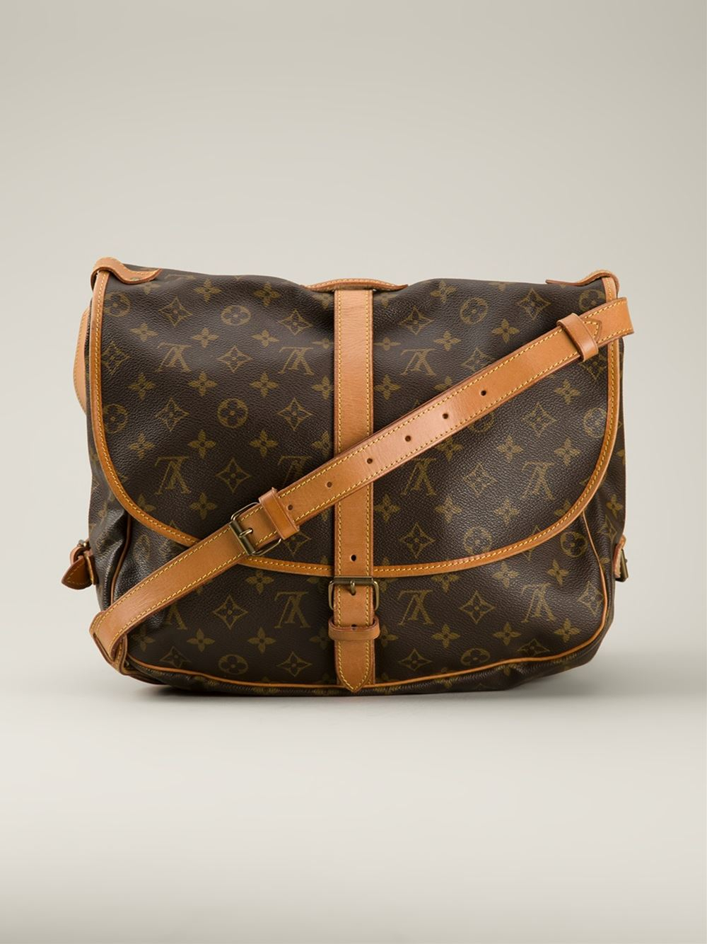louis vuitton saumur 35 shoulder bag in brown lyst