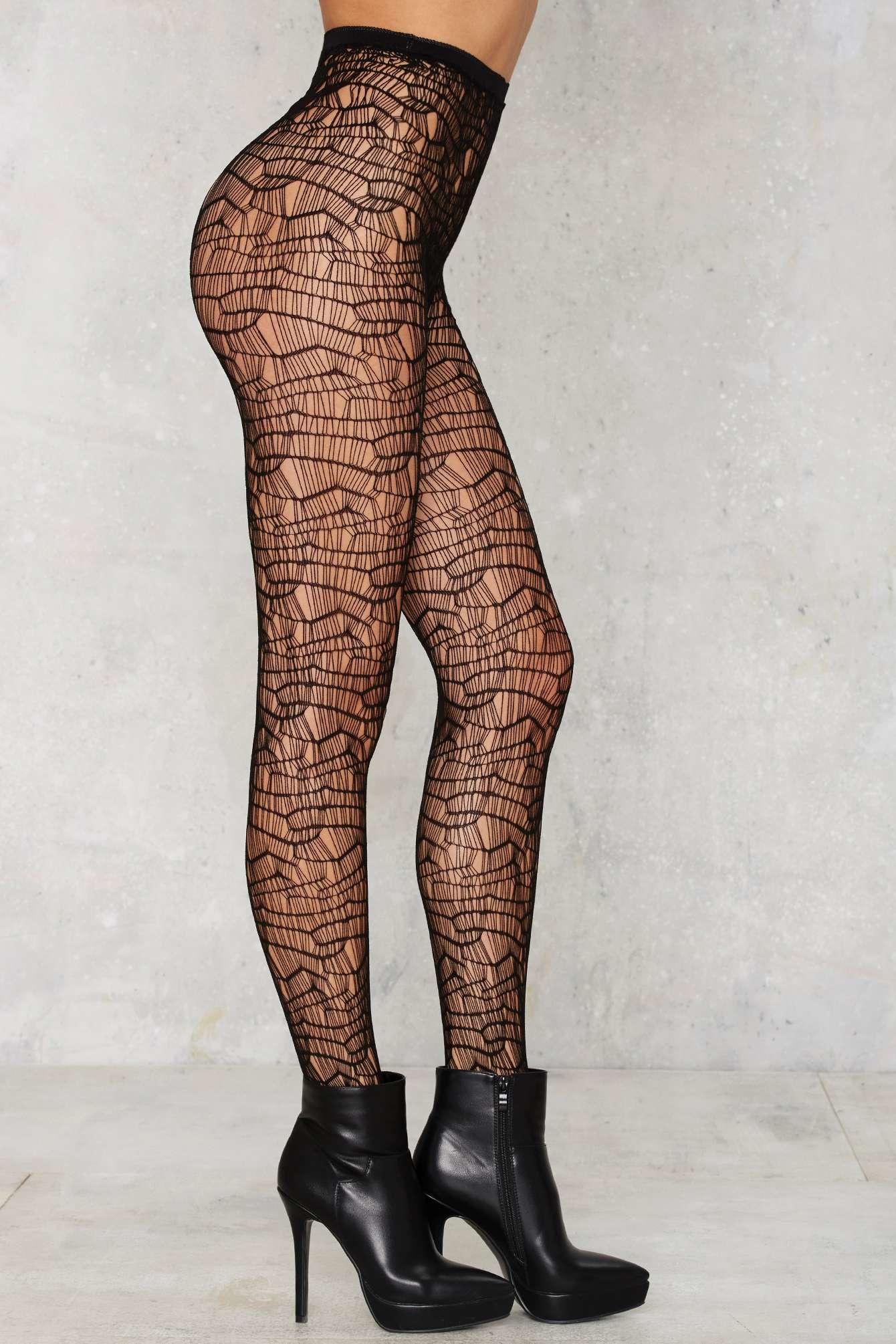 7f1b1da8a Nasty Gal Look From London Rihanna Fishnet Tights in Black - Lyst