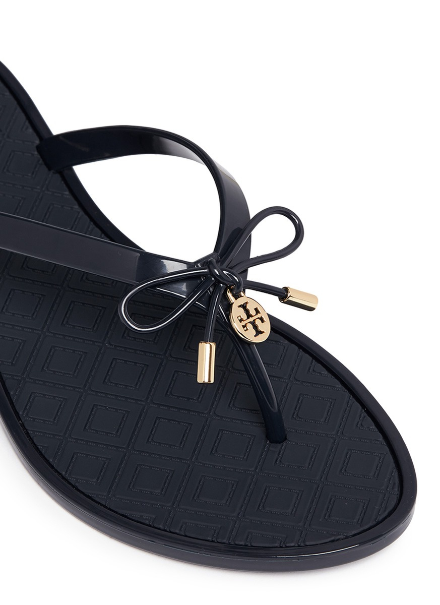 c239e15f684c Lyst Tory Burch Jelly Bow Embossed Flip Flops In Blue. Valentino ...