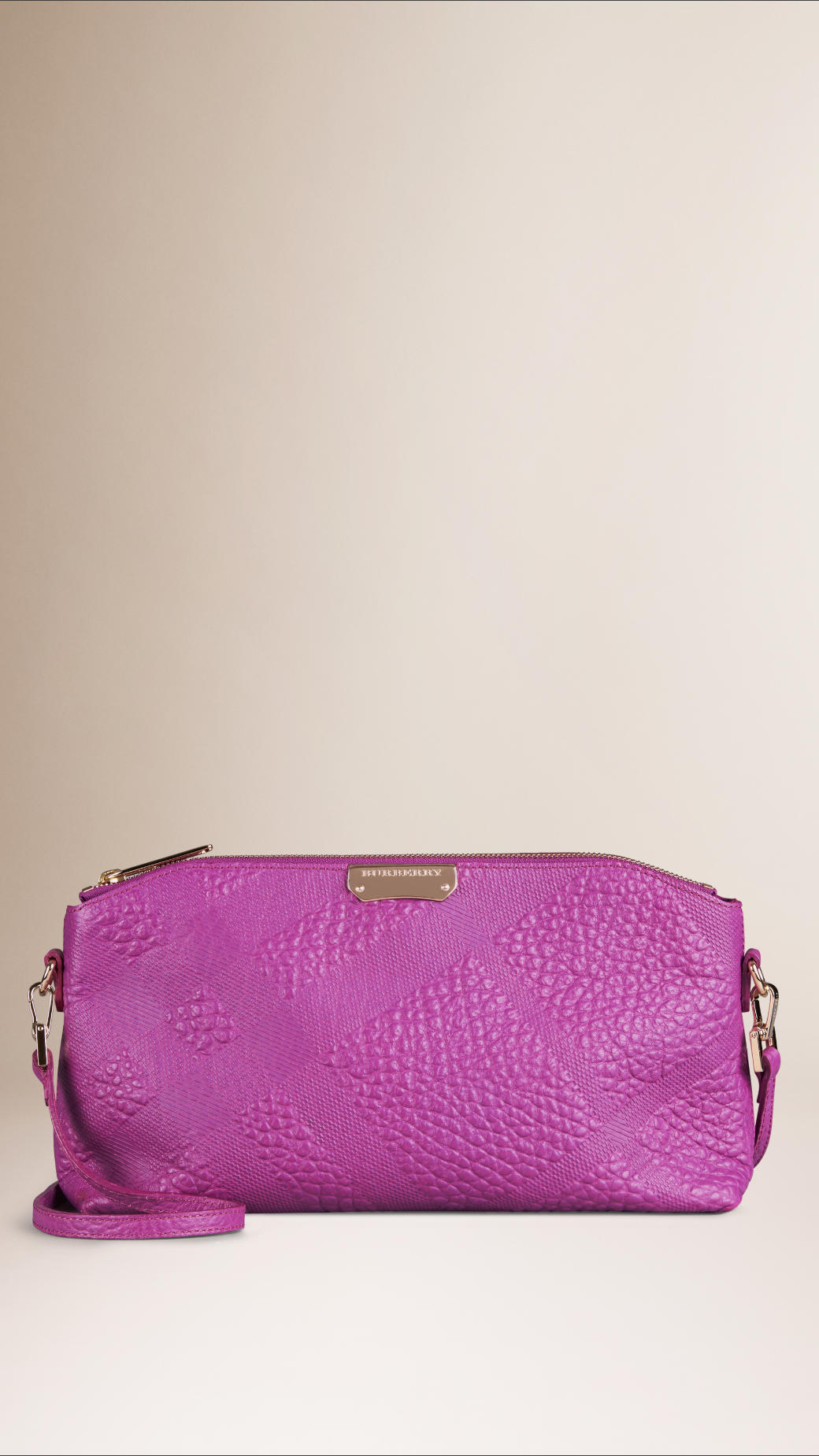 b08d9c3af777 Lyst - Burberry Small Embossed Check Leather Clutch Bag in Purple