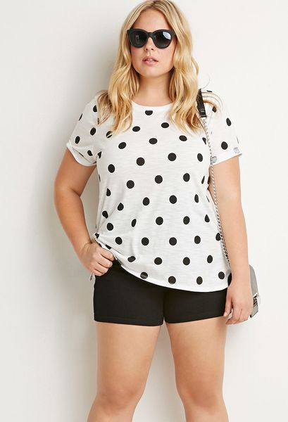 You will be in this comfy polka dot tee, finished with a tie front and scoop-neckline. This versatile design will work with just about any pants, jeans or skirts in your closet. Elbow sleeves. Length: 24