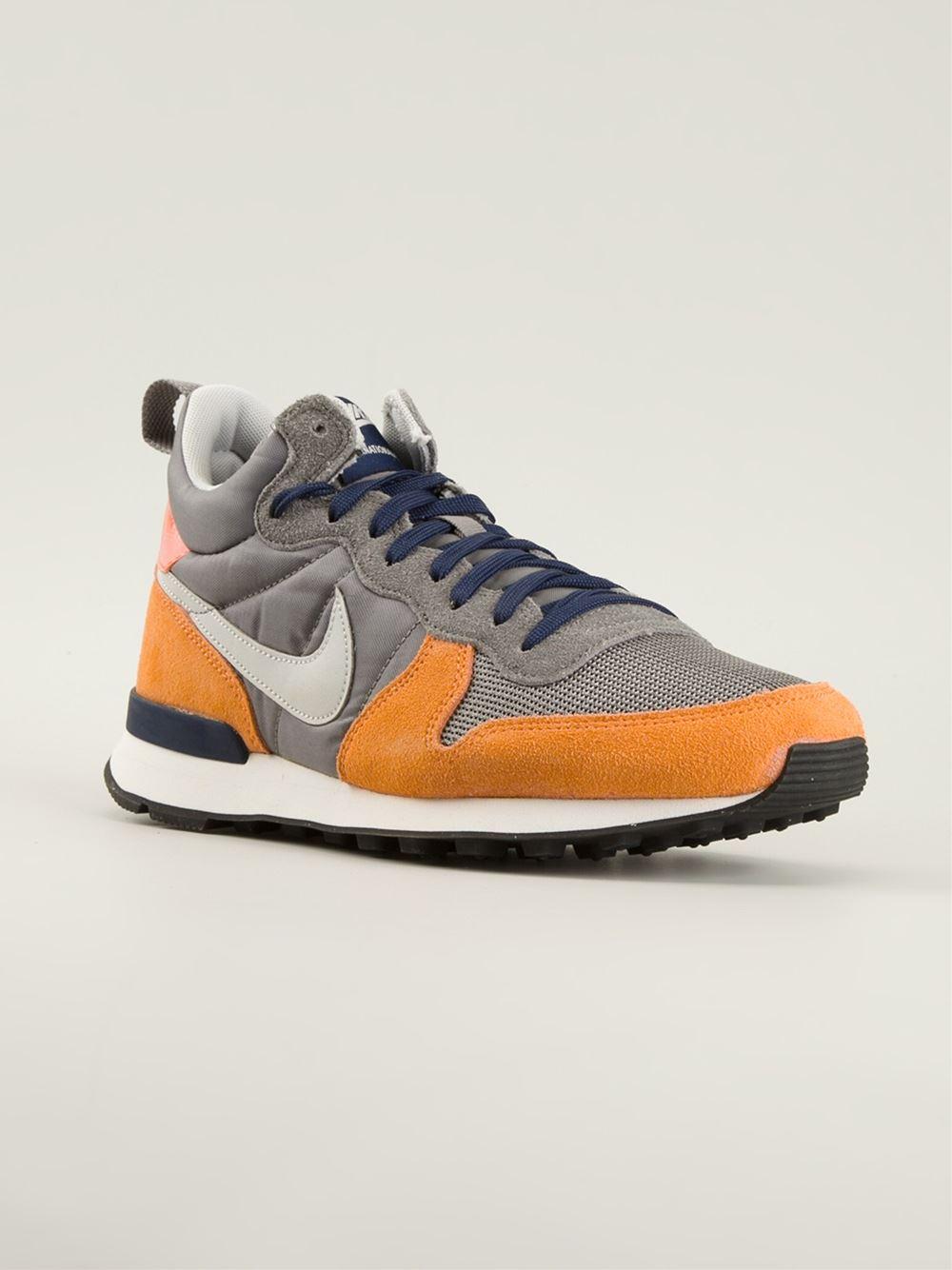 nike internationalist orange grey
