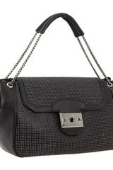 Alexander McQueen Studded accents shoulder bag - Lyst