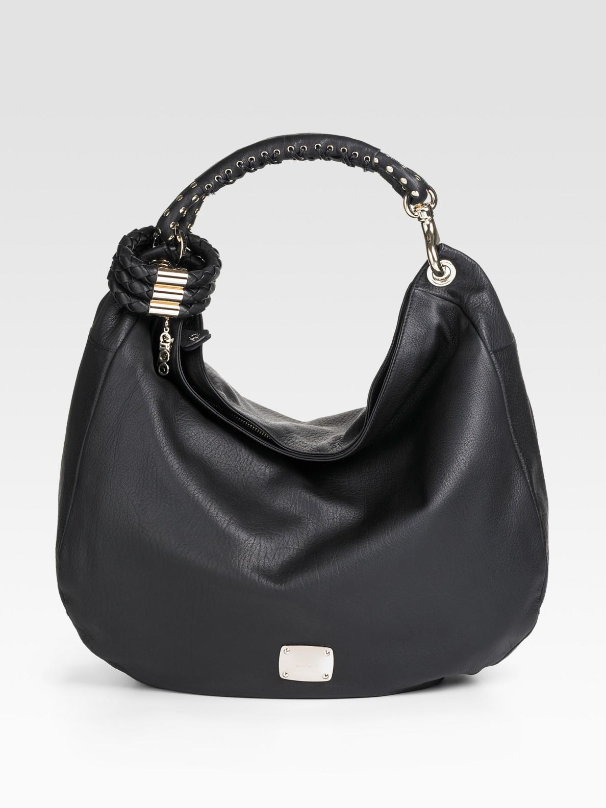 23418082bfa Jimmy Choo Black Leather Sky Studded Bangle Hobo in Black - Lyst