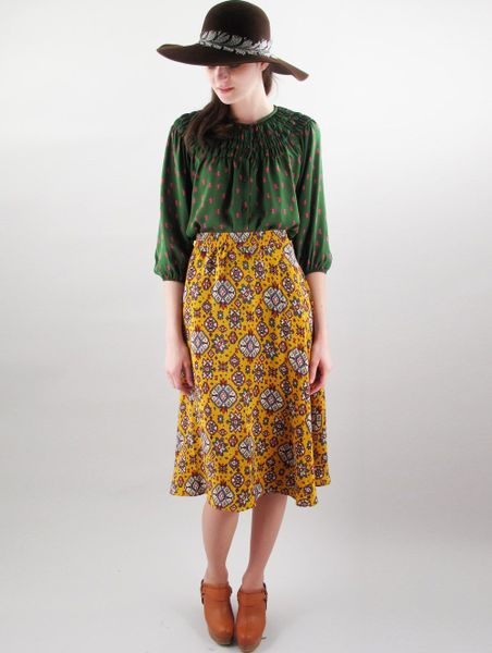 tucker flowy knee length skirt in brown saffron lyst