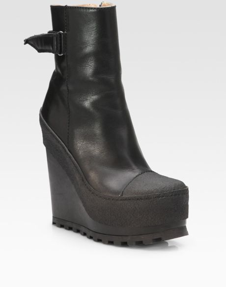 acne studios leather and rubber wedge ankle boots in black