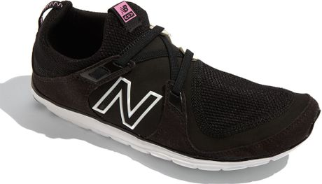 www.lyst.com/shoes/new-balance-black-minimus-walking-shoe-women