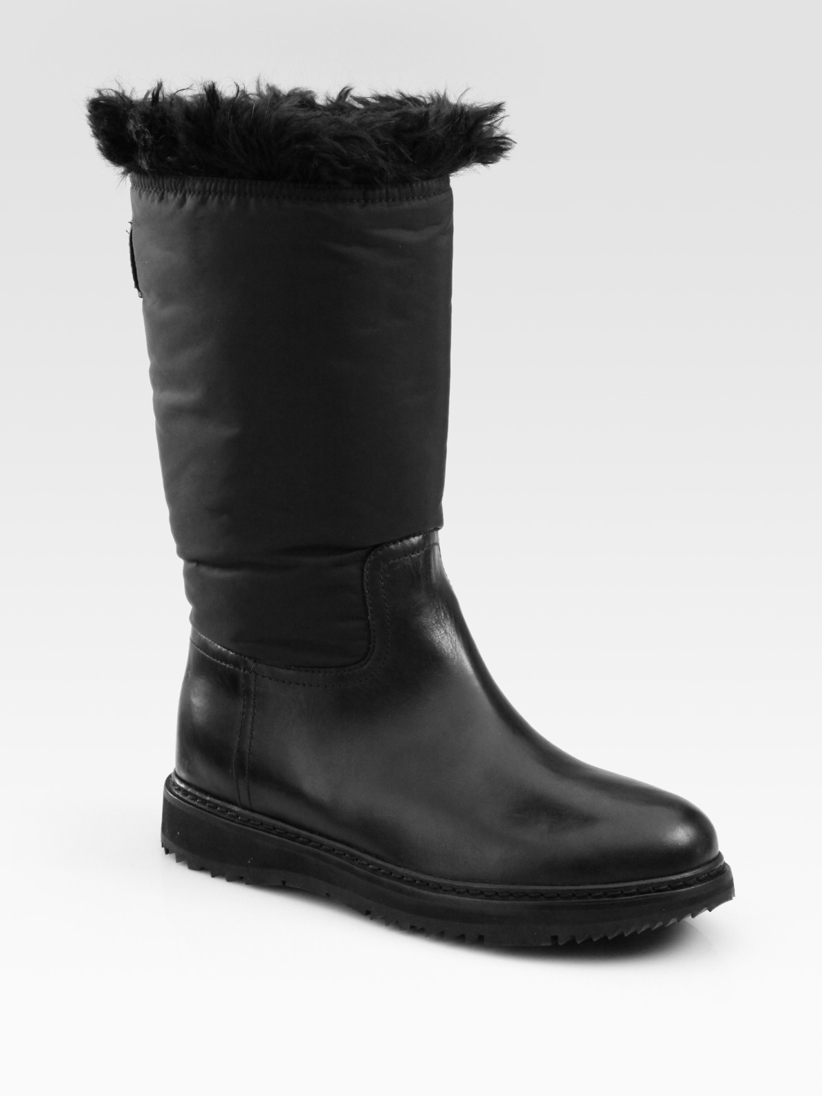 prada leather and mid calf faux fur lined boots in