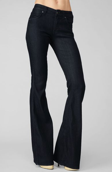 Updated skinny jeans in a rich hue. Single-button closure and zip fly. You are considering a pair of jeans from Rich and Skinny. All of my laundry is done with cold water on the delicate cycle with all natural, dye and additive free detergent and hung to dry.