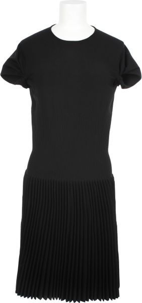 Alaïa Fitted Knit Dress in Virgin Wool and Polyester in Black - Lyst