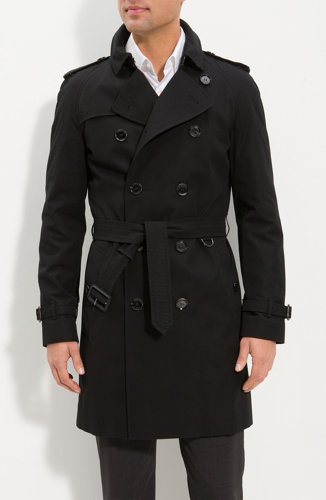 Stay prepared for whatever weather by stepping out in this trench coat that ties at the waist for a flattering fit.