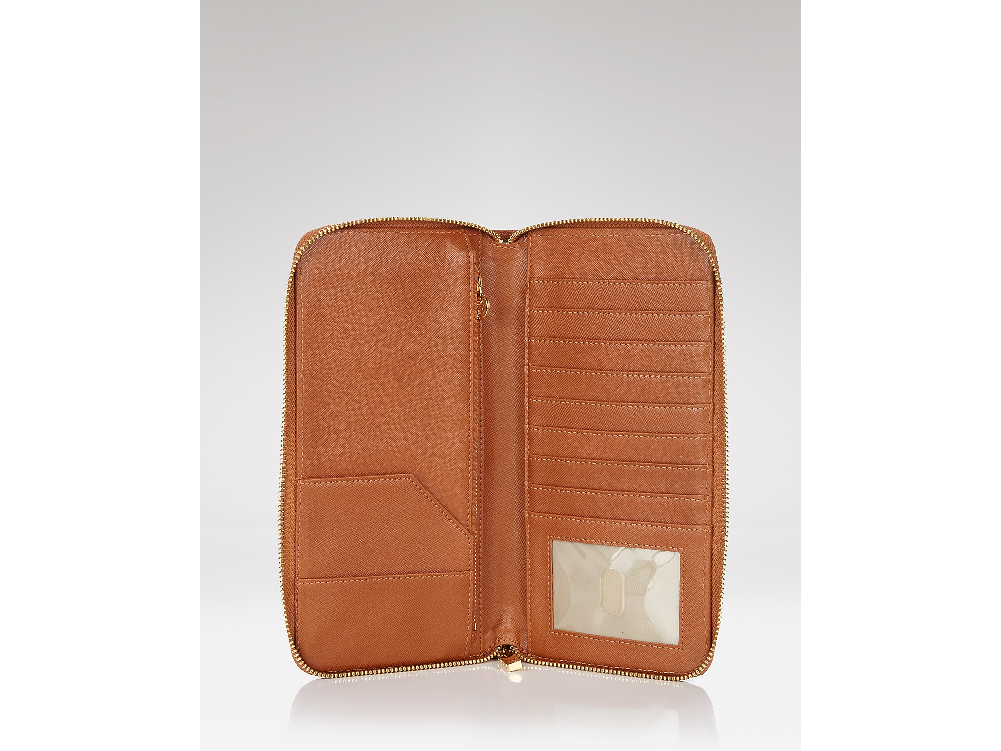 ddb1c1da3131 ... Parker Travel Zip Continental Wallet In Black. Gallery. Lyst Tory Burch  Robinson Travel Wallet In Brown