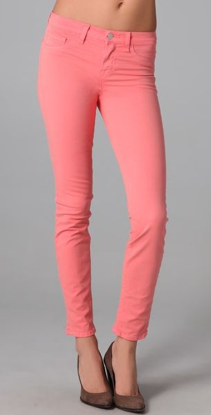 J Brand 811 Mid Rise Skinny Jeans in Pink (coral)