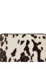 Alexander Mcqueen Peppered Pony Continental Wallet in Animal - Lyst