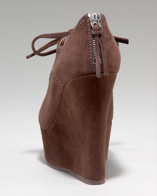 Lyst Miu Miu Suede Peep Toe Zip Back Wedge Bootie In Brown