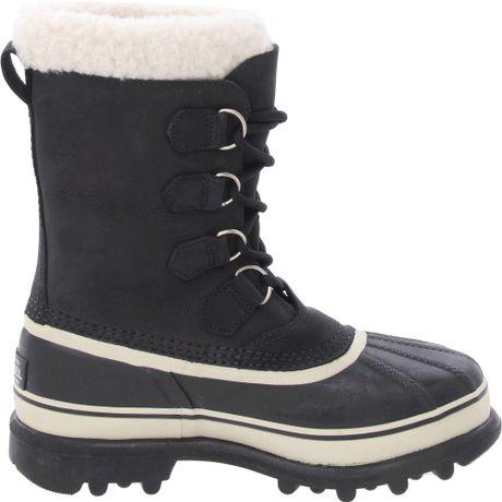 sorel womens caribou boot in black black lyst