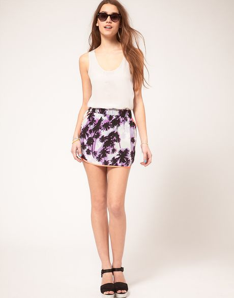 Asos Collection Asos Dolphin Hem Mini Skirt in Palm Tree Print in Purple (print)