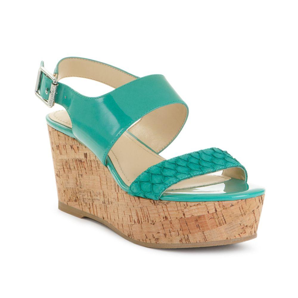 07007a7d74 Lyst - Calvin Klein Lorianne Flatform Sandals in Green