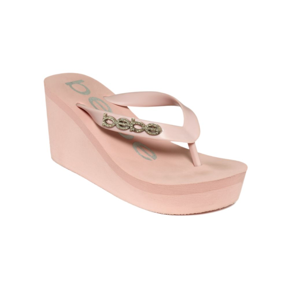 5682bac17a2b Lyst - Bebe Kristy Wedge Flip Flop Sandals in Pink