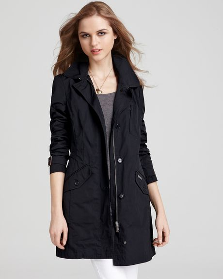 Woolrich Travel Coat in Black - Lyst